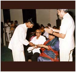 Receiving an award from legendary vocalist D K Pattammal.